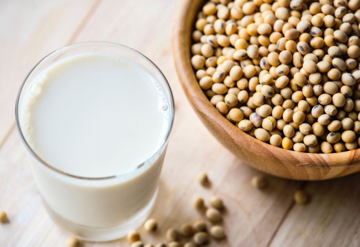 a glass of milk and soybeans